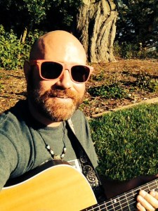 sitting in the grass, playing the guitar with the sun smacking my face. why WOULDN'T I be smiling?