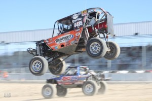 Sacalas Jumping next to Lovell 300x199 High Flyin Sacalas Beats King Campbell in Latest Ultra4 Race