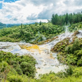 Orakei Korako. Artist's Palette is an almost level, 10,000m2 silica sinter terrace. Silica sinter on Artist's Palette fills an old hydrothermal eruption crater that formed between 8,000 - 14,000 years ago. Remnants of the hydrothermal crater wall form steep steaming ridges.