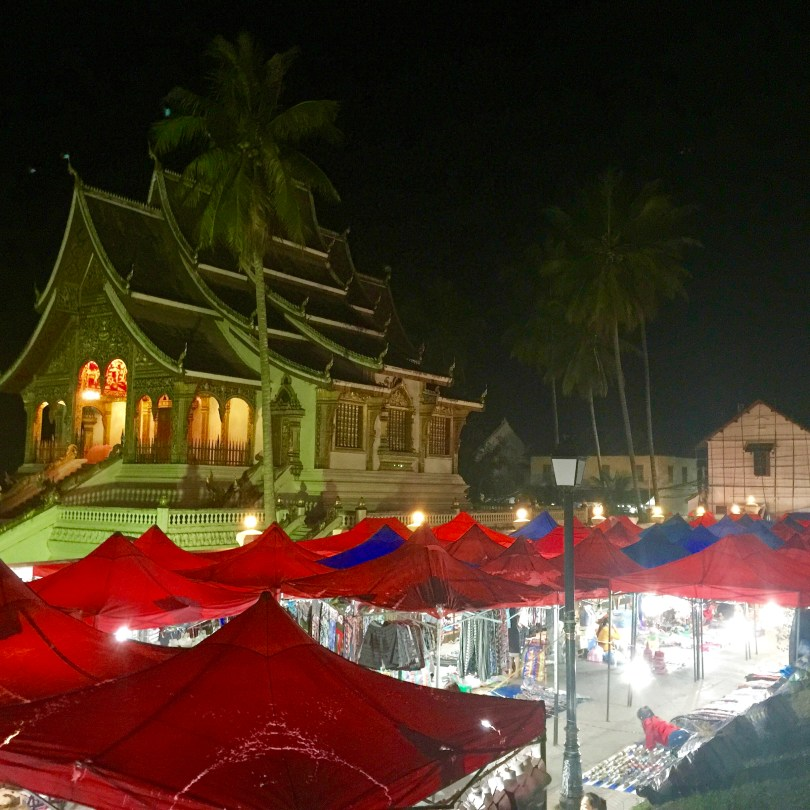 Night market at Luang Prabang with the Royal Palace temple in background