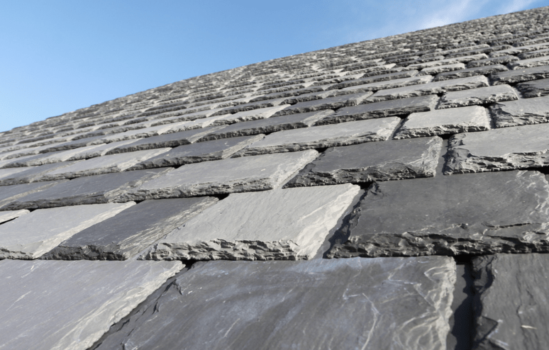Polymer tiles replicate natural slate roofing for Polymer roofing