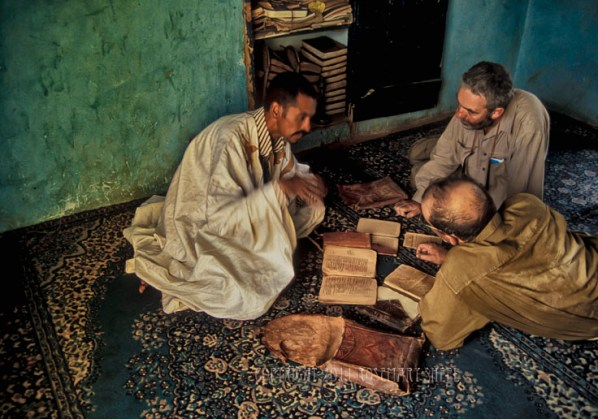 A Moorish man shows the ancient manuscripts of Chinguetti