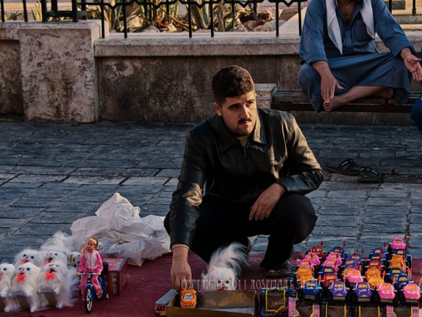 A young man sells toys in the Aleppo Souk