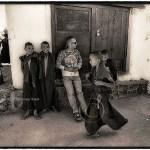 Ladakh:European man at monastery with boy monks