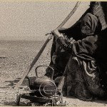 berber woman sits by her tent