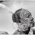 Karo man with face paint