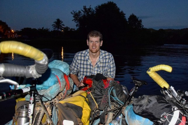 Alex, two bikes and me wedged into tiny boat
