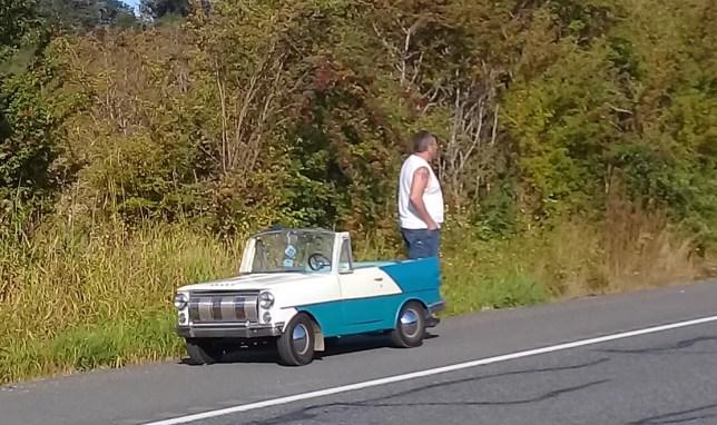 man with tiny car