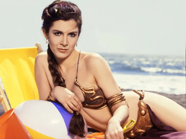 Carrie Fisher in Slave Leia Gold Bikini from Rolling Stone 1983