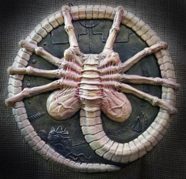 alien facehugger wall plaque sculpture by Micky Betts