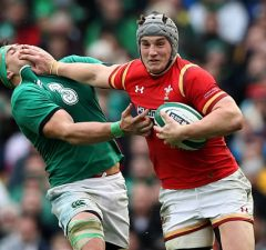 Jonathan Davies shpves off CJ Stander in the tackle