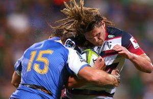 Jordy Reid of the Rebels gets tackled by Dane Haylett-Petty of the Force
