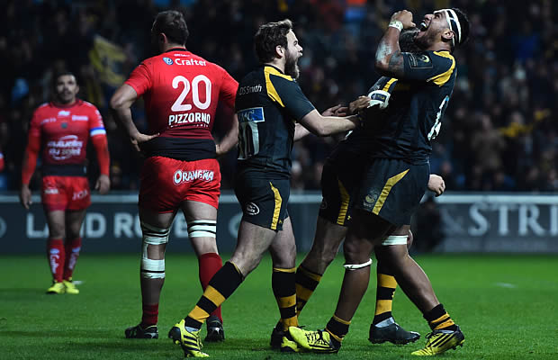 Nathan Hughes celebrates his second try of the match