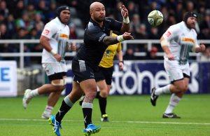 Try scorer Nili Latu clears the ball for Newcastle Falcons