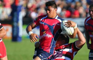 Pete Samu of Tasman is tackled