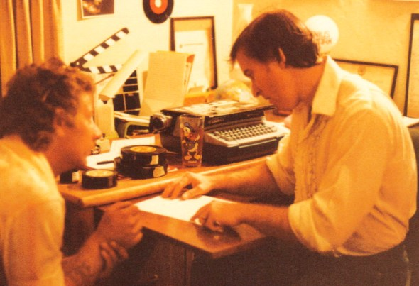 Director Cartel goes over song lyrics and melody with writer/musician Jim Coons (l.) during post production