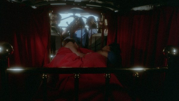 What appears to be a romantic scene with Jason in a bedroom turns out to be in the back of a traveling van.