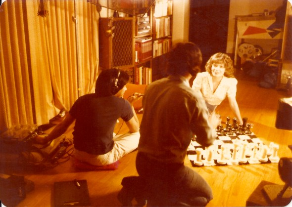 Mike (back to camera) gives Jody direction for her chess sequence.