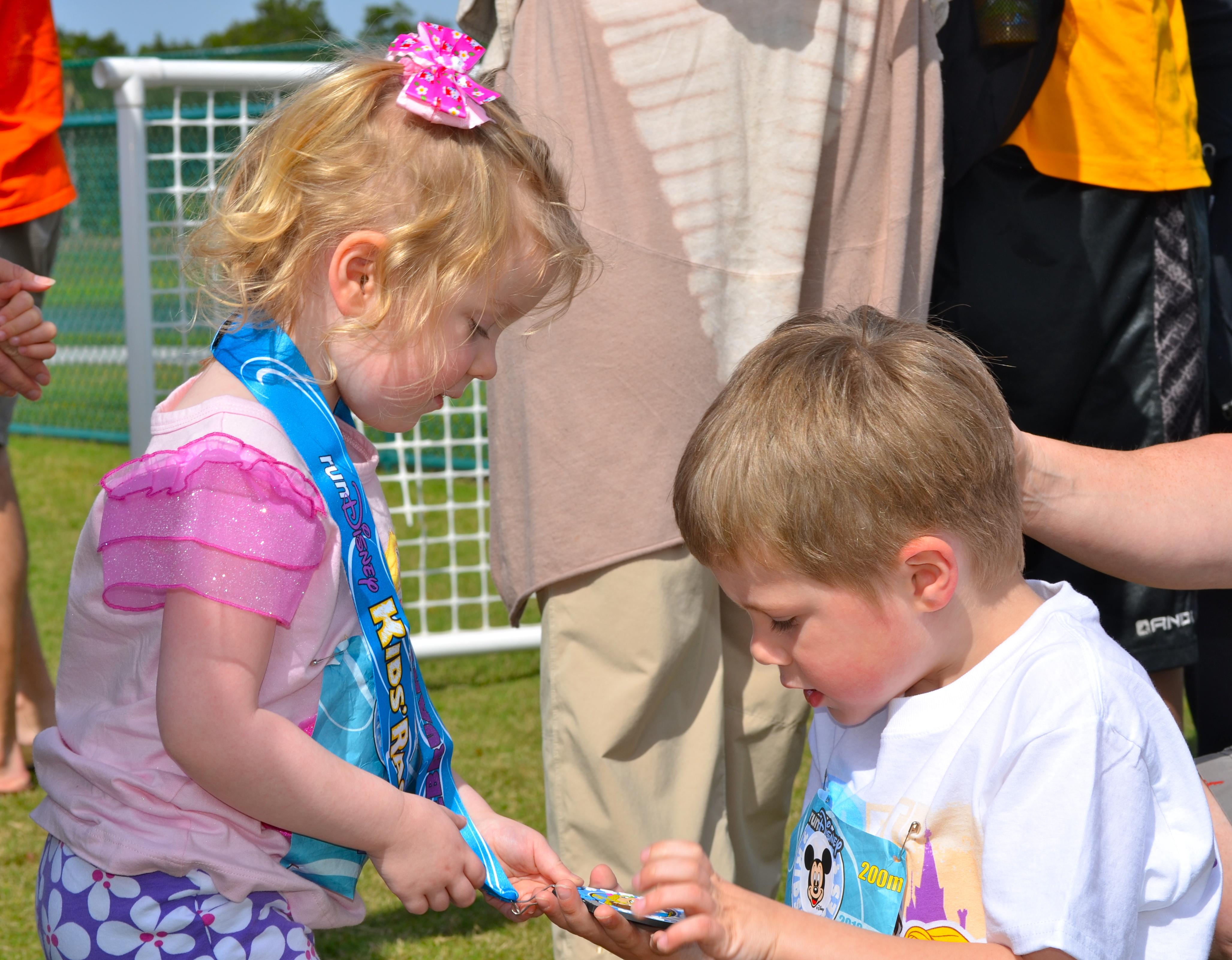 My nephew admires his sister's medal