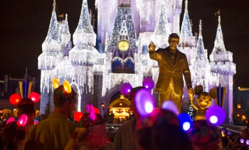 "Walt and Mickey watch over Magic Kingdom in the ""Partners"" statue. (Photo: Gene Duncan/Walt Disney World News)"