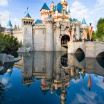 """SLEEPING BEAUTY CASTLE — Sleeping Beauty Castle at Disneyland park in Anaheim, Calif., is the centerpiece of Fantasyland and one of the most recognizable structures in the world. Surrounded by placid water, beautiful flowers and whimsical topiary, the Disneyland landmark beckons park visitors to explore the different realms of the """"Happiest Place on Earth.""""   (Paul Hiffmeyer/Disneyland Resort)"""
