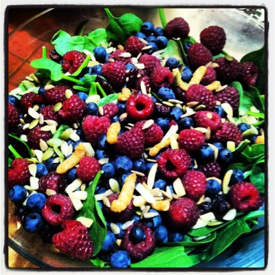 Fruit and berry spinach salad - chock full of nutrient-dense carbohydrates.