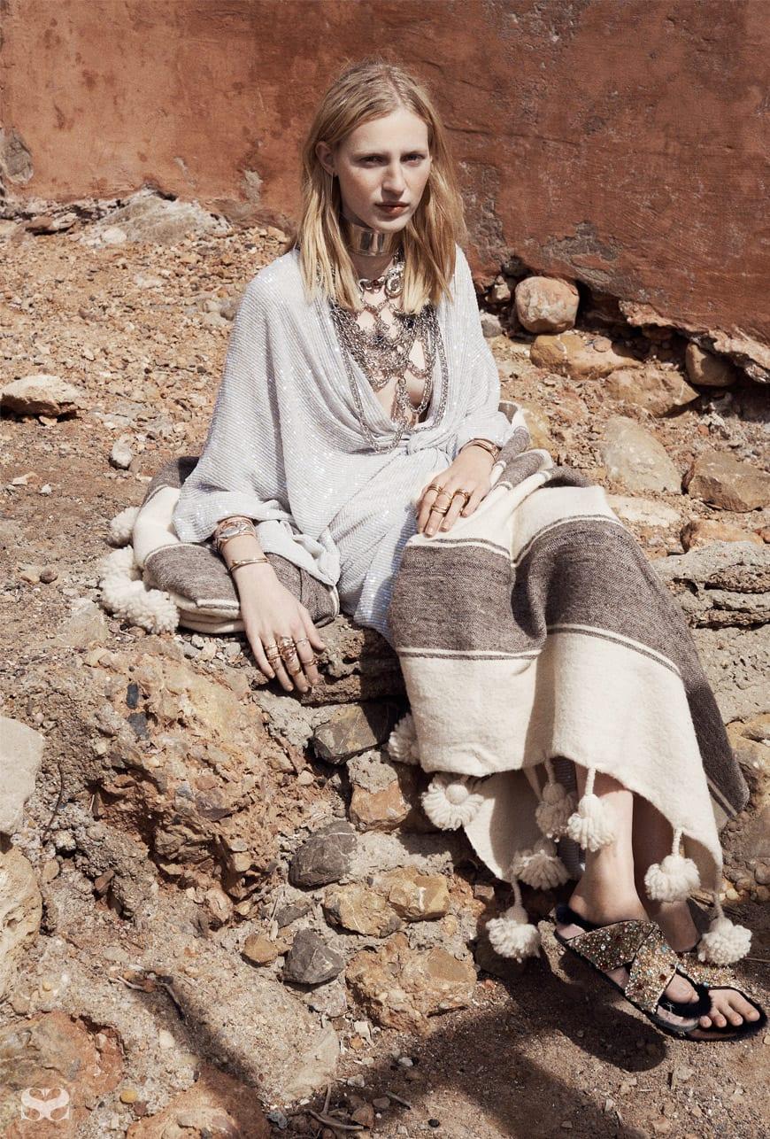 DIANE VON FURSTENBERG dress; RODARTE necklaces; stylist's own blanket.