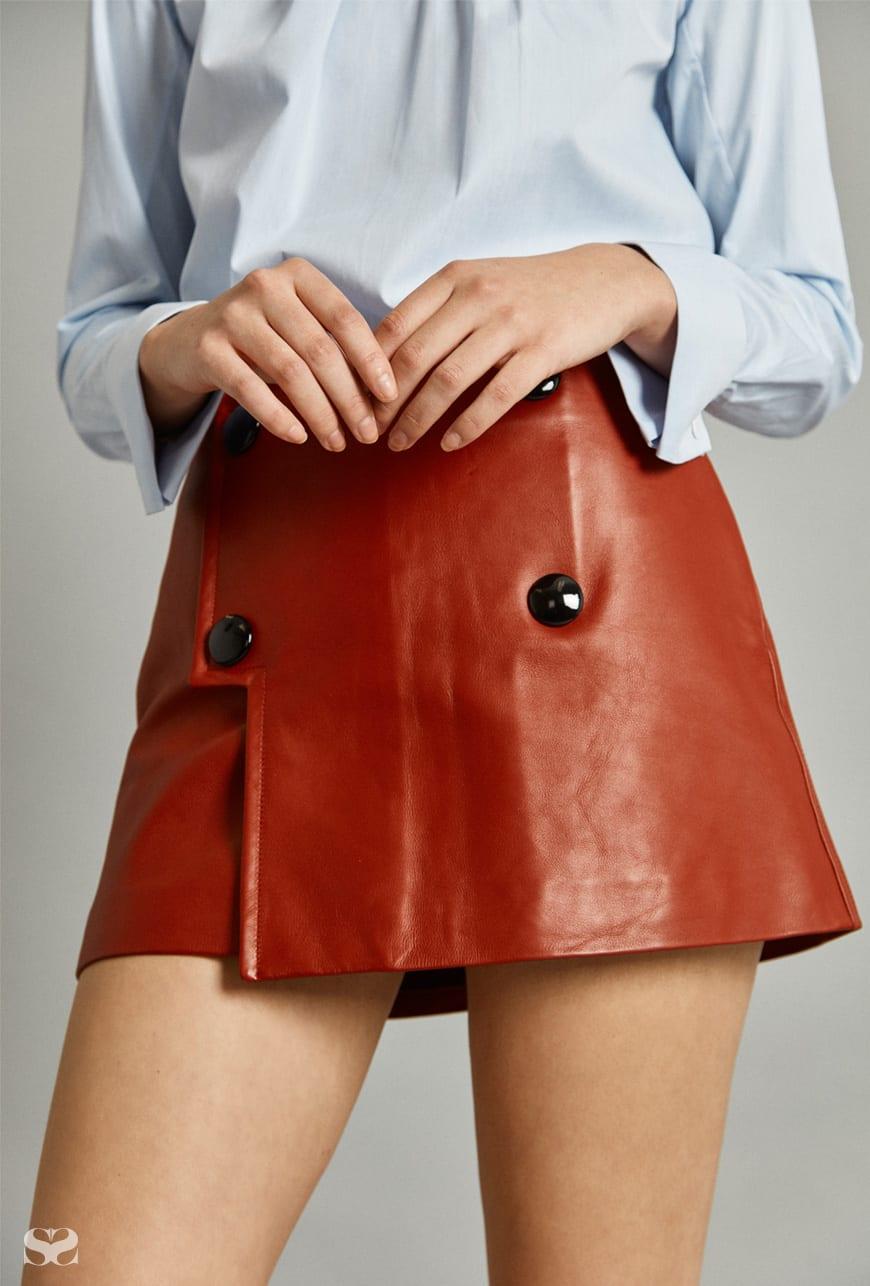 SANDRO top; BALLY skirt.