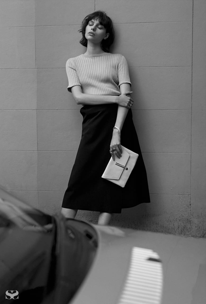 GREGORY top; MARIMEKKO skirt; MIMCO bag and rings.