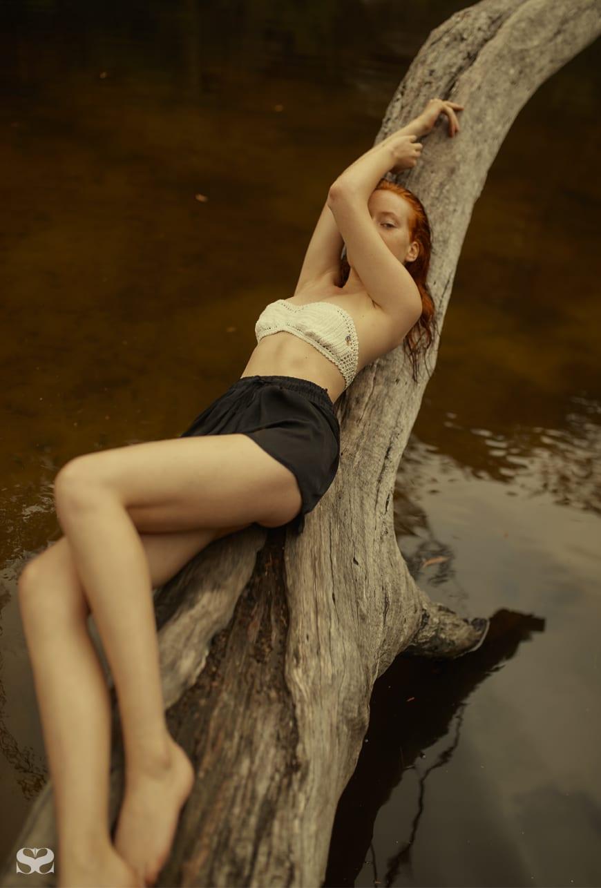 SHE MADE ME bikini top; stylist's own shorts.