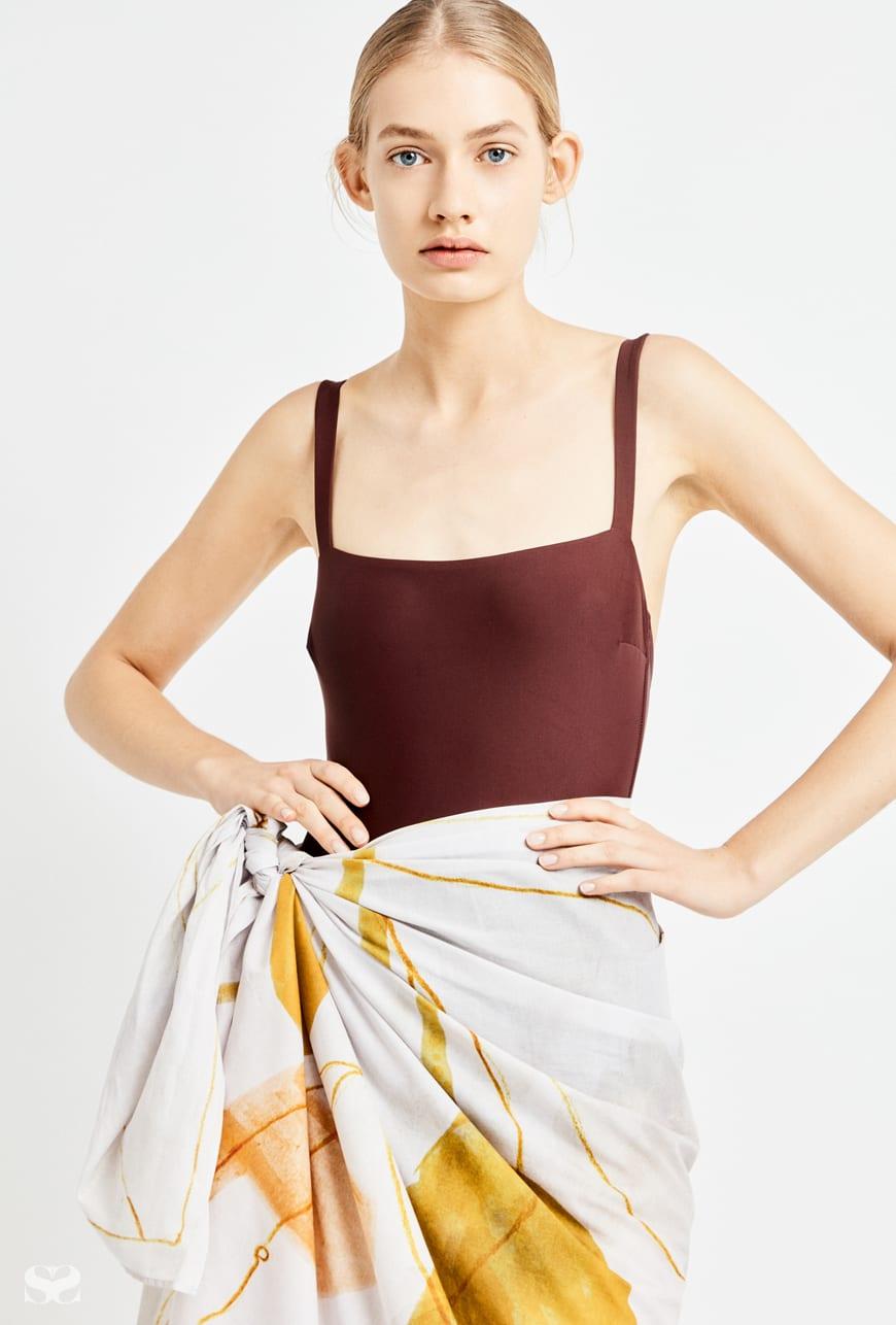MATTAEU SWIM swimsuit; MIRADOR sarong.