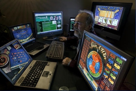 internet onling gambling dangers addiction image picture computers screens light