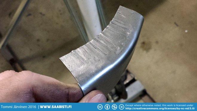 Shrinker teeth marks on a piece of metal.