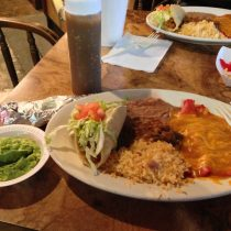 The Mexican plate: two cheese enchiladas, carne guisada, puffy taco, rice and beans.