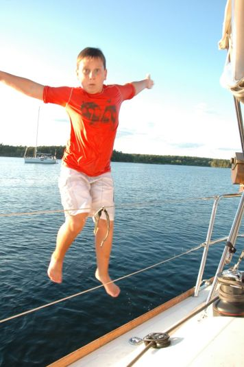 Thomas also enjoys jumping off the boat.