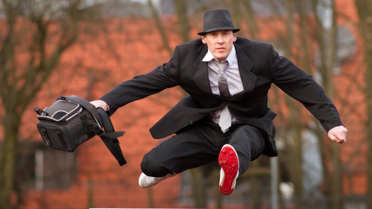 Businessman Jumping Hurdle Overcoming Common Blow-Off Objections