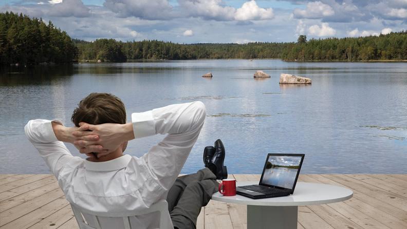 Businessman Near Lake Too Much Work
