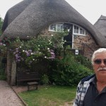 Bill in front of the funny thatch