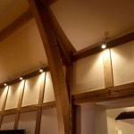 Lounge lighting with wooden beams by Sam Coles Lighting 06