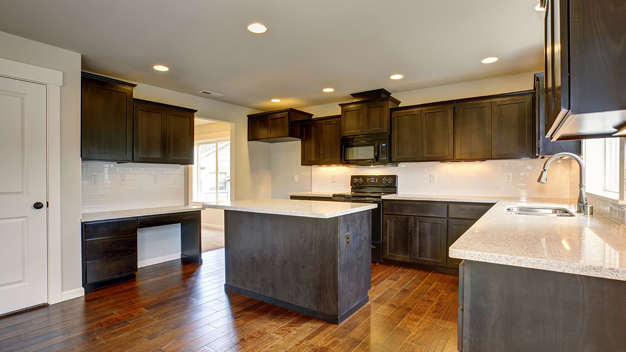 should you stain or paint your kitchen cabinets for a change in color stained