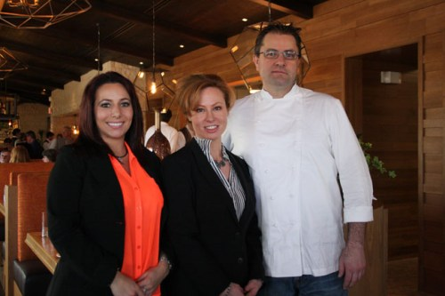 Tavern on the Coast owners (L to R) Veronica Scala, Pamela Dickinson and Bryan Podgorski celebrate the grand opening of their new restaurant Tavern on the Coast. Photo by Andrea Swayne