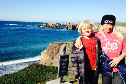 Bryce and Kirra Pinkerton stoked to be surfing the central coast but bummed that their session was cut short by a shark attack Sunday at Montaña de Oro State Park. Photo: Ashley Pinkerton