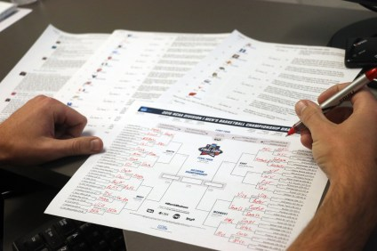 Filling out an NCAA Basketball Tournament bracket has become a ritual for college basketball fans. Photo: Eric Heinz