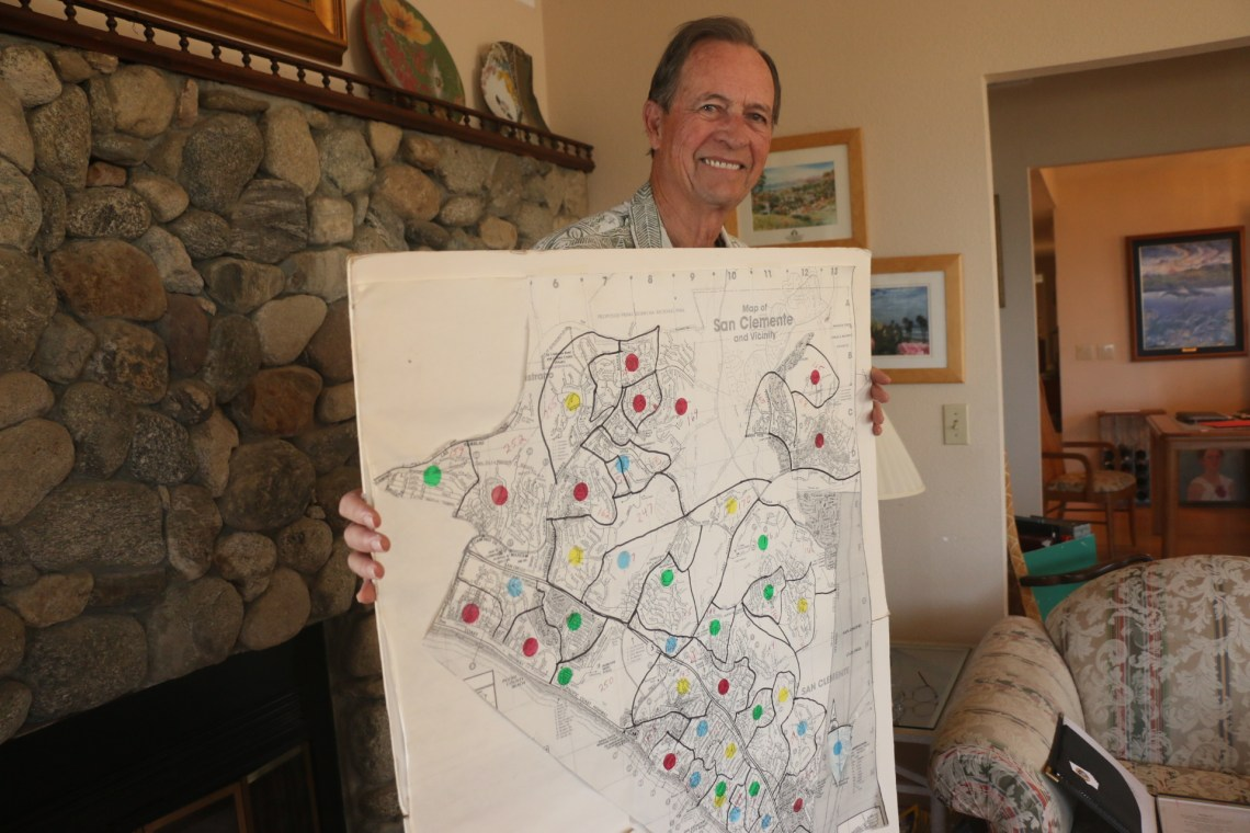 Joe Anderson holds up a map his wife, Mary Anna, put together of the various precincts around San Clemente during his City Council campaign in 1998. Photo: Eric Heinz