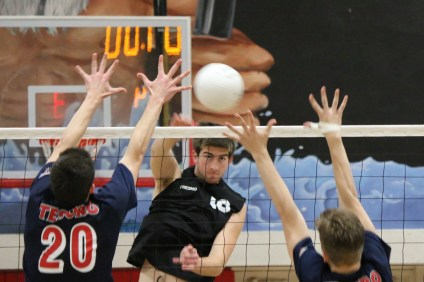 Kyler Presho, middle, and the San Clemente boys volleyball team shutout their opponents 13 times this season. Photo: Monica Merrill