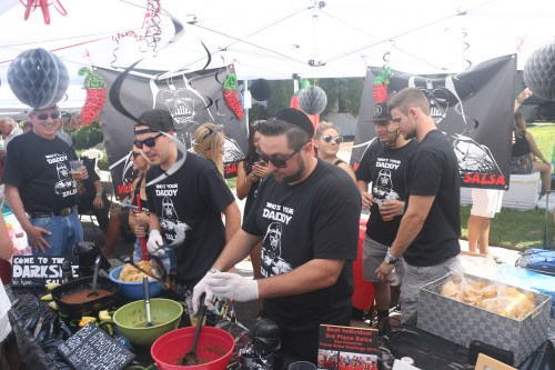 Members of Who's Your Daddy Salsa serve up their recipe during the 63rd annual San Clemente Fiesta Music Festival on Sunday, Aug. 14, on Avenida Del Mar.