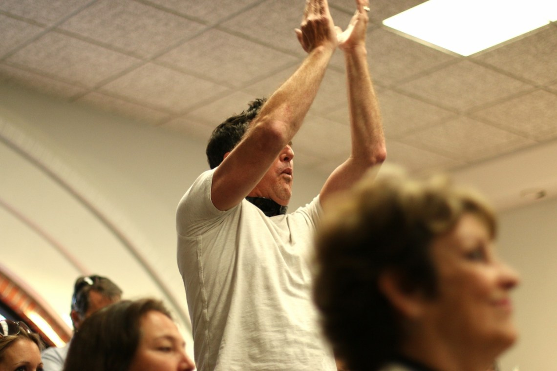 People in the audience broke out into cheers and applause on Tuesday, May 2, after each time a public speaker demanded the City Council to amend a letter to the Coastal Commission to revoke the permit to store nuclear waste at SONGS. Photo: Eric Heinz