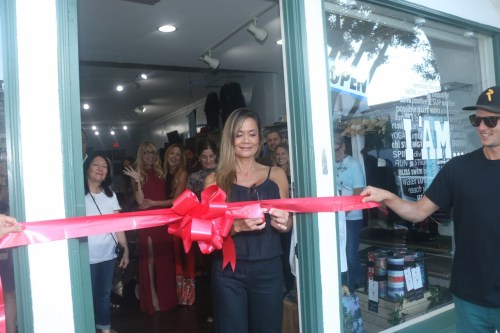 Tina Shreeve, owner of I 'AM… Active Lifestyle Wear, cuts the ribbon to her business during a grand opening on Friday, June 9. The business is located at 103 Avenida Del Mar in San Clemente. Photo: Eric Heinz
