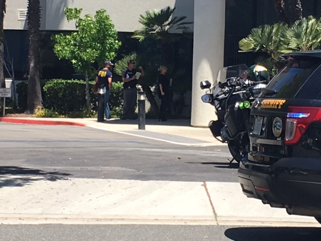 Orange County Sheriff's Department officials and FBI talk outside of Vedanta Laboratories in San Clemente, CA on Tuesday, June 13, 2017. Photo by Eric Heinz