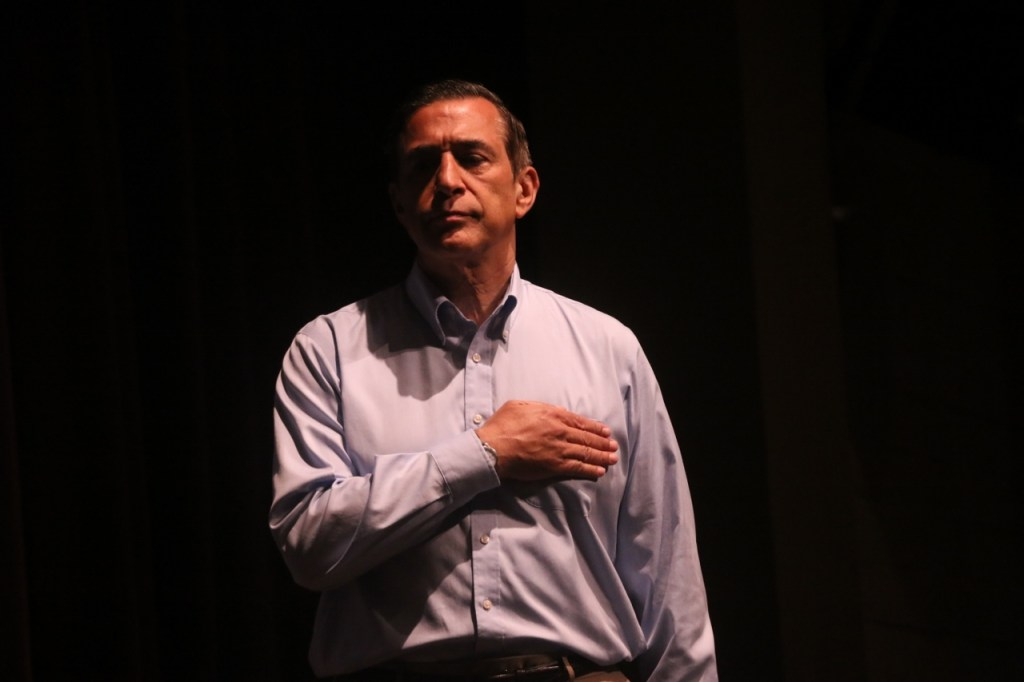 Rep. Darrell Issa, (R) CA-49, stands for the Pledge of Allegiance on Saturday morning, June 3, at San Juan Hills High School. The congressman hosted a town hall meeting. Photo: Eric Heinz